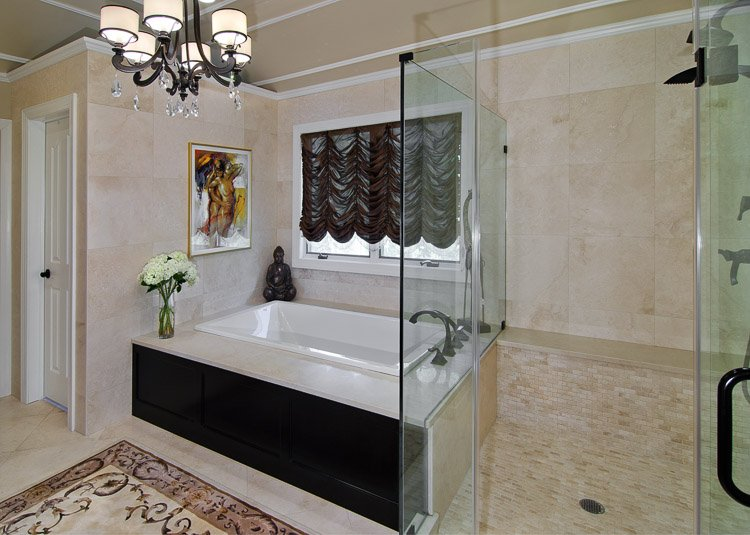 Bathroom with large soaker tub and glass shower