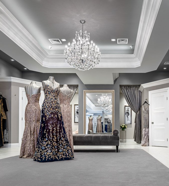 Emily's boutique with three mannequins wearing ornate dresses