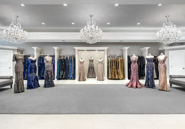 Emily's Boutique with nine mannequins, racks of dresses and three chandeliers