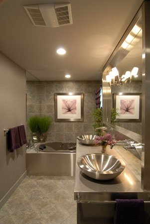 Grey bathroom with a tub and a double vanity with mirror