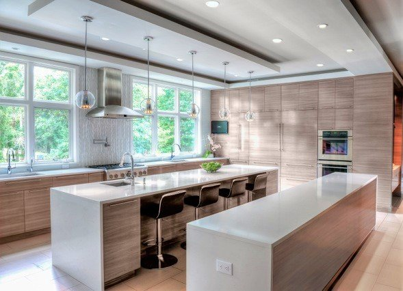 Dual island kitchen with lots of windows, pendant lights, lots of windows and seating for four
