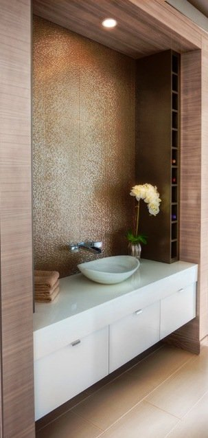 White floating vanity with white vessel sink and orchid