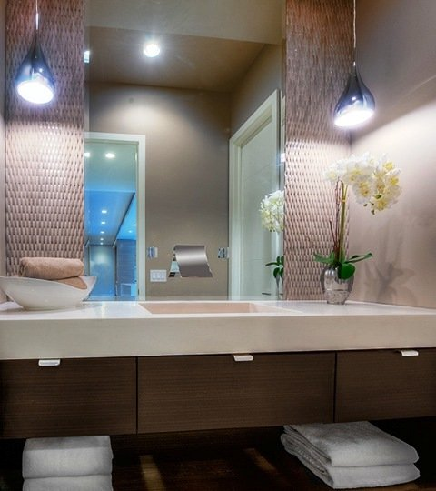 Floating vanity with sink and mirror with two pendant lights above