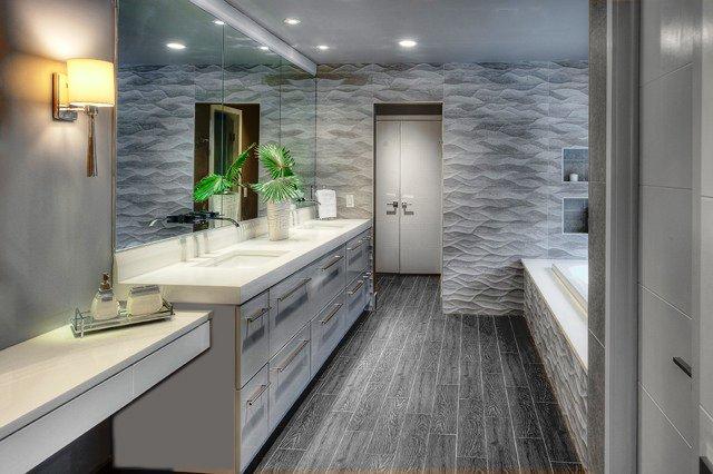 Grey bathroom with tub and dual vanity