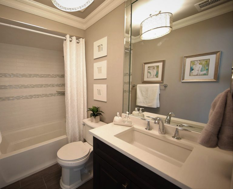Bathroom with vanity, toilet and shower/tub combo
