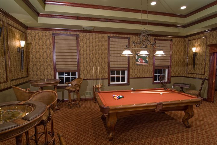 Billiard room with pool table and tables and chairs