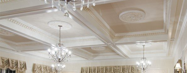 Ornate ceiling architectural details with medallions, coffers and chandeliers