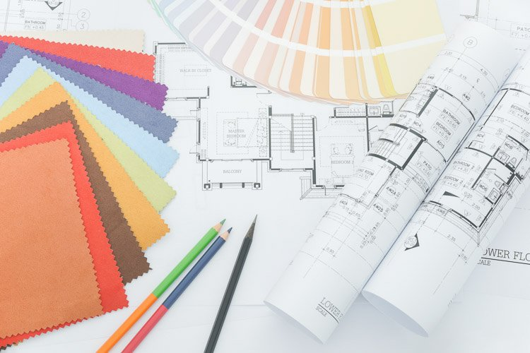 Assorted fabric samples and paint samples with architectural plans