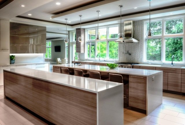 Interior Design Staten Island kitchen with two islands, wood cabinetry and large windows