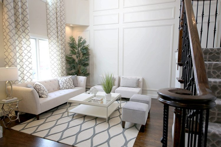 Living room with white couch and additional seating