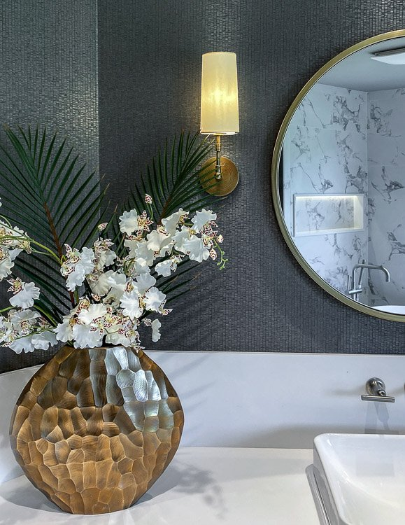 Master bath vanity with vase and flowers