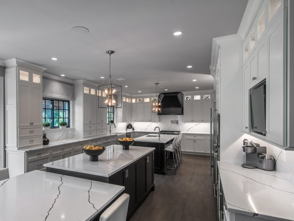 Kitchen with double island and white cabinets