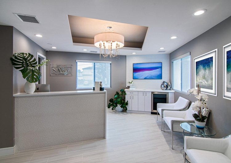 Dentist office reception area with desk and waiting area