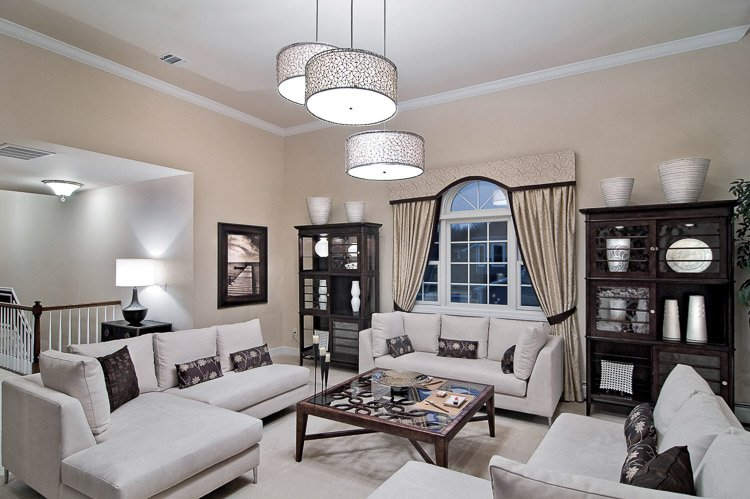 Living room with lots of seating, bookshelves and a large window